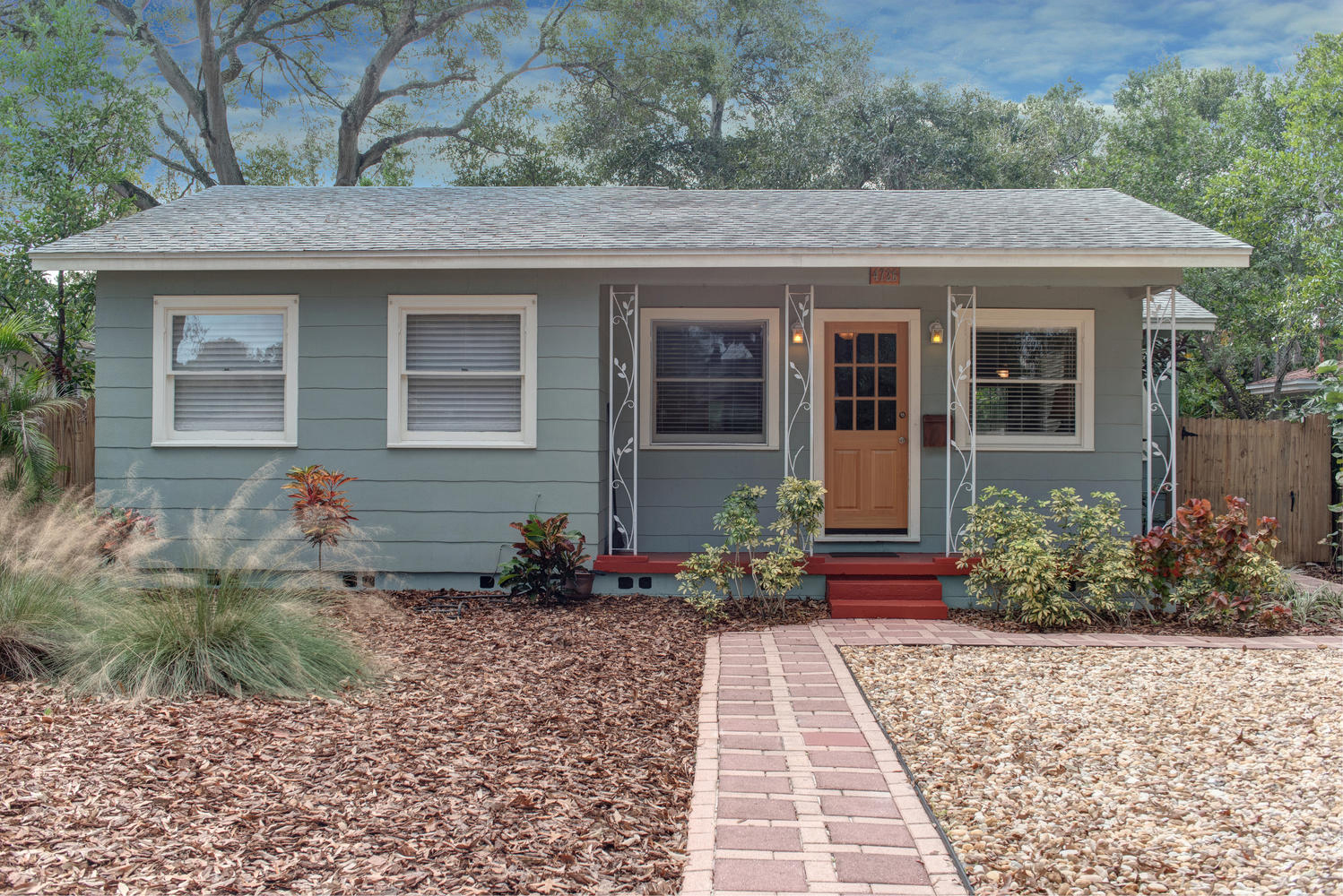 Staged cozy 1940 39 s st pete bungalow cardinal designs for 1940s homes exterior design