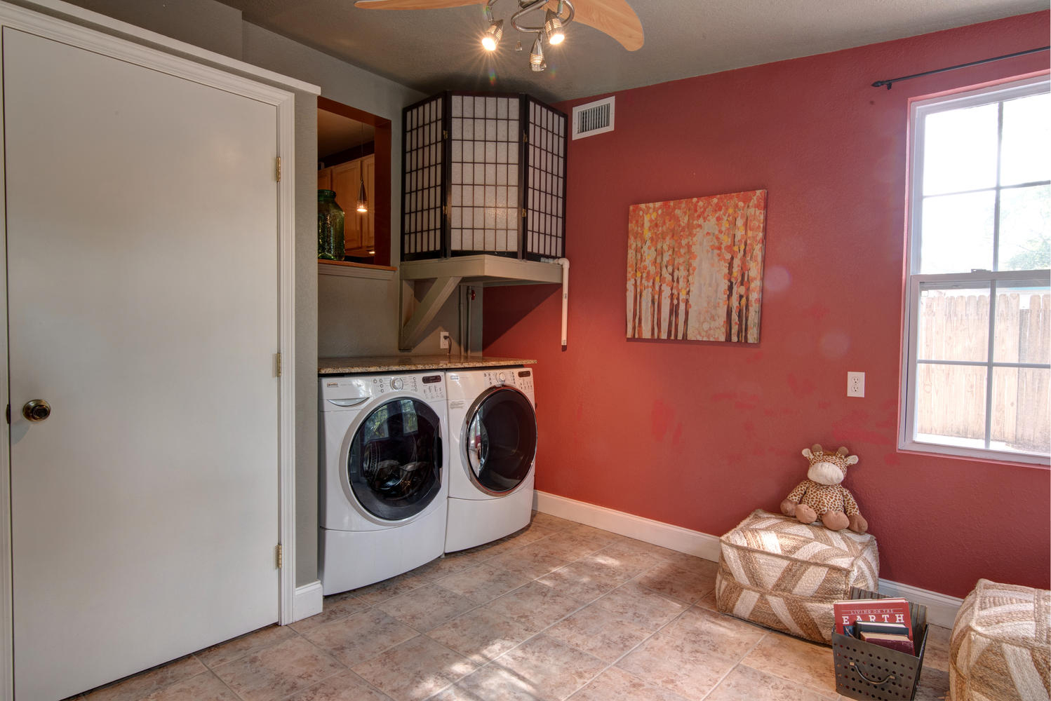 staged cozy 1940 s st pete bungalow den and laundry room